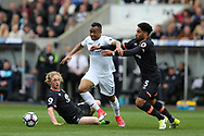 Jordan Ayew of Swansea city © is tackled by Everton's Tom Davies (l) and Ashley Williams ®. Premier league match, Swansea city v Everton at the Liberty Stadium in Swansea, South Wales on Saturday 6th May 2017.<br /> pic by  Andrew Orchard, Andrew Orchard sports photography.