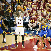 10 June 2016: Cleveland Cavaliers forward LeBron James (23) takes a jump shot over Golden State Warriors forward Harrison Barnes (40) and Golden State Warriors center Andrew Bogut (12) during the Golden State Warriors 108-97 victory over the Cleveland Cavaliers, during Game Four of the 2016 NBA Finals at the Quicken Loans Arena, Cleveland, Ohio, USA.