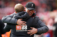 Football - 2019 / 2020 Premier League - Liverpool vs. AFC Bournemouth<br /> <br /> Liverpool manager Jürgen Klopp  hugs Bournemouth manager Eddie Howe before the start of the match, at Anfield.<br /> <br /> <br /> COLORSPORT/TERRY DONNELLY