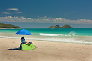 Vacationer relaxing on Bellows beach on Oahu, Hawaii