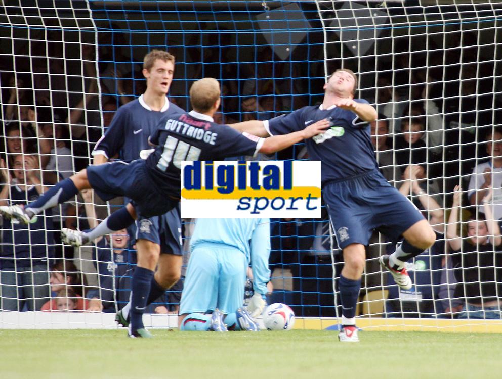 Photo: Chris Ratcliffe.<br />Southend United v Sunderland. Coca Cola Championship. 19/08/2006.<br />Luke Guttridge (L) jumps on goalscorer Lee Bradbury as they celebrate scoring the third Southend  goal.