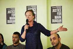 © Licensed to London News Pictures. 30/01/2014. London, UK. Carol Duggan attends during a public debate at North London Community Centre on Mark Duggan's trial. Photo credit : Andrea Baldo/LNP