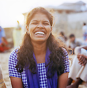 Portrait of a woman laughing, Papanasham Beach (the Beach of Redemption), Varkala, Kerala, India