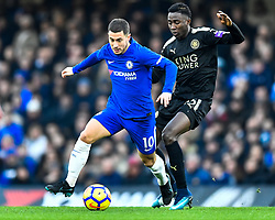 January 13, 2018 - London, England, United Kingdom - Chelsea's Eden Hazard battles for possession with Leicester City's Onyinye Wilfred Ndidi..during the Premier League match between Chelsea and Leicester City at Stamford Bridge, London, England on 13 Jan t 2018. (Credit Image: © Kieran Galvin/NurPhoto via ZUMA Press)