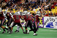 4/12/2007 - David Short (12) drops back behind his offensive line for a pass against the Frisco Thunder in the first professional football game in the State of Alaska.