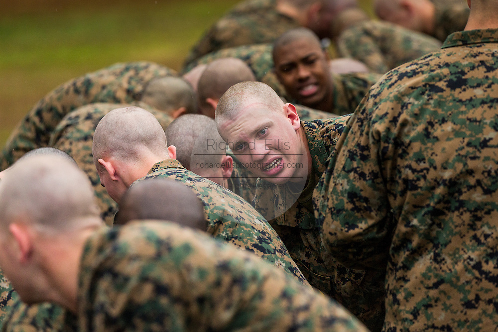 US Marine recruits choke and gasp for air after exiting the gas chamber during bootcamp January 13, 2014 in Parris Island, SC.