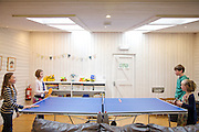 The games room at Pickwell Manor, Georgeham, North Devon, UK. From left to right: Liza Baker (9), Molly Elliott (10), Zac Baker (11), <br /> Milly-grace Elliott (8).<br /> CREDIT: Vanessa Berberian for The Wall Street Journal<br /> HOUSESHARE