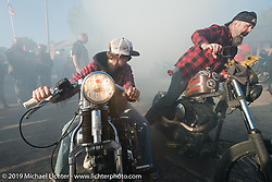 Daren McKeag along with a friend do a side by side burn-out at Willie's Tropical Tattoo annual Old School Bike Show during Daytona Bike Week. FL, USA. March 13, 2014.  Photography ©2014 Michael Lichter.