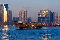 A dhow cruising down Dubai Creek, Dubai, United Arab Emirates