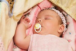 Polish baby girl sleeping peacefully in cot,