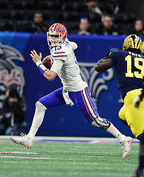 Florida Gators quarterback Feleipe Franks (13) scrambles during the Chick-fil-A Bowl Game against Michigan Wolverines at  the Mercedes-Benz Stadium, Saturday, December 29, 2018, in Atlanta. ( Kyle Hess via Abell Images for Chick-fil-A Kickoff)
