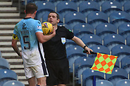 Callum Morris and Douglas Ross, (Assistant referee) argue on the touchline during the Scottish Premiership match between Rangers and Ross County at Ibrox, Glasgow, Scotland on 4 October 2020.