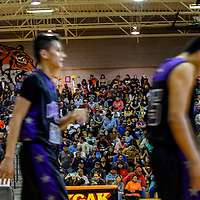 020615  Adron Gardner/Independent<br /> <br /> A packed house watches as the Miyamura Patriots walk to the locker room at half time during a cross-town game with the Gallup Bengals.  The school was forced to halt admission after reaching reccomended capacity.