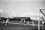 17/02/1963<br /> 02/17/1963<br /> 17 February 1963<br /> Soccer: Shamrock Rovers v Cork Celtic at Glenmalure Park, Milltown. Shamrock Rovers goalie Henderson (on left) fails to clear this high ball from a corner kick.