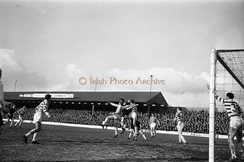 17/02/1963<br /> 02/17/1963<br /> 17 February 1963<br /> Soccer: Shamrock Rovers v Cork Celtic at Glenmalure Park, Milltown. Shamrock Rovers goalie Henderson (on left) fails to clear this high ball from a corner kick.