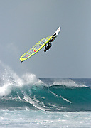 Windsurfing at Hoʻokipa Beach on the north shore of Maui, Hawaii.  Hoʻokipa Beach is the most renowned windsurfing site in the world.