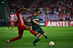 September 20, 2018 - Piraeus, Attiki, Greece - Giovani Lo Celso (no 21) of Real Betis tries to avoid Ahmed Hassan (no 18) of Olympiacos  (Credit Image: © Dimitrios Karvountzis/Pacific Press via ZUMA Wire)