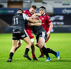 James Davies of Scarlets under pressure from Luke Morgan of Ospreys<br /> <br /> Photographer Simon King/Replay Images<br /> <br /> Guinness PRO14 Round 11 - Ospreys v Scarlets - Saturday 22nd December 2018 - Liberty Stadium - Swansea<br /> <br /> World Copyright © Replay Images . All rights reserved. info@replayimages.co.uk - http://replayimages.co.uk