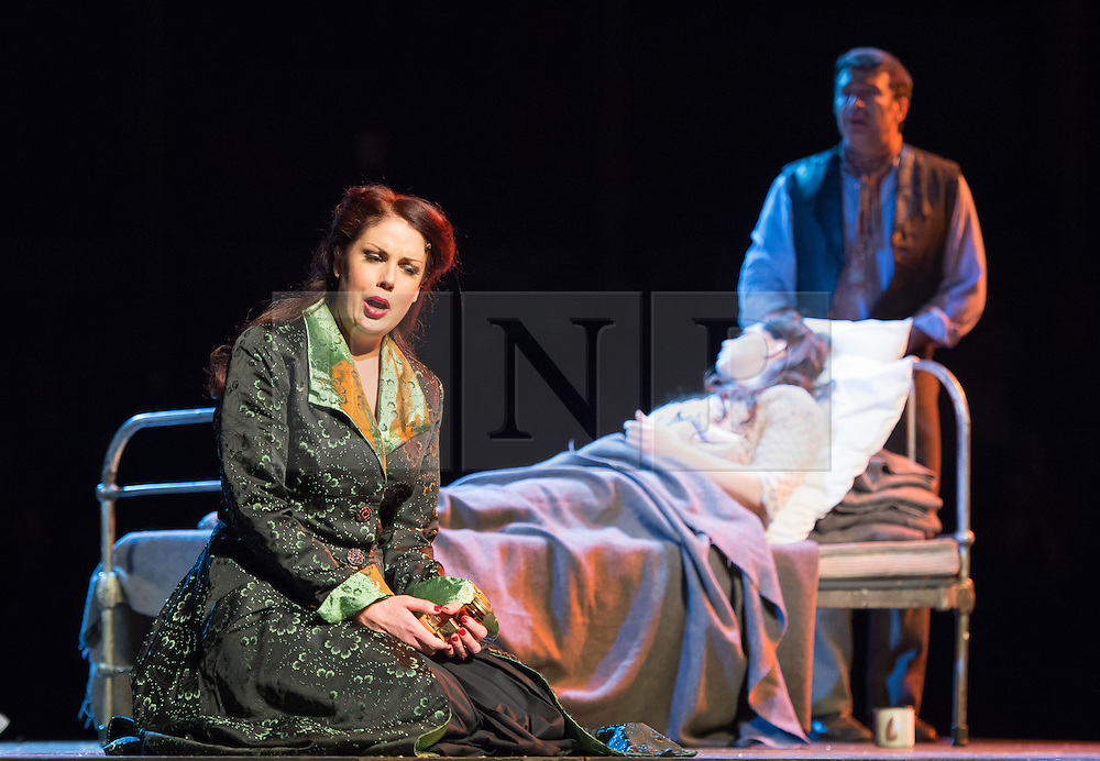 © London News Pictures. (L-R) Anna Leese as Musetta, Jessica Rose Cambio as Mimi & Stefano De Peppo as Schaunard perform in Puccini's tragic opera La Boheme at The Royal Albert Hall, London on February 26, 2014.   Photo credit: Arnaud Stephenson/LNP