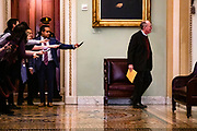 WASHINGTON, DC - JANUARY 30: Reporters reach out with their cell phones and audio recorders trying to get a statement from Sen. Lamar Alexander (R-TN) as he passes by during a recess in the Senate impeachment trial of President Donald Trump on January 30, 2020 in Washington, DC. The trial has entered into the second day of the question phase where Senators have the opportunity to submit written questions to the House managers and President Trump's defense team. (Photo by Samuel Corum/Getty Images) *** Local Caption *** Lamar Alexander