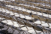 Empty rows of folding chairs.