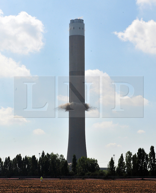 © Licensed to London News Pictures. 07/09/2016<br /> Frame 2<br /> Grain Power Station chimney demolition in Kent.<br /> <br /> One of the country's tallest structures has been demolished this morning at 11am.<br />  The Power Station chimney is 244m (801 ft) which makes it taller than Canary Wharf in London. <br /> <br />  The demolition is a British record for the tallest concrete structure to be blown up!<br /> <br /> <br /> <br /> (Byline:Grant Falvey/LNP)