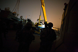 In the middle of the night, engineers with the 82nd Airborne Division and soldiers with Charlie Co. 1-26 Infantry 1st Infantry Division work to raise a wall, amongst much controversy, around the beleaguered Baghdad Sunni district of Adhamiya on Sunday April 28, 2007.