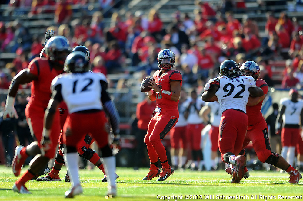 Quarterback Gary Nova #10 of Rutgers looks for an open receiver during American Athletic Conference Football action between Rutgers and Cincinnati on Nov. 16, 2013 at High Point Solutions Stadium in Piscataway, New Jersey.