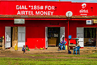 Shops are paintd with advertisements forAirtel, a telecom company in Uganda; Fort Portal, Kabarole District, Uganda.