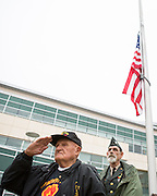 "Ed Hart, United States Army veteran of the Korean War (1953-1954), foreground, and Kraig Bunnell, United States Army veteran of the Vietnam War, salute during the playing of ""Armed Forces Salute"" during the Milpitas Memorial Day Ceremony at Veterans Memorial Flag Plaza in Milpitas, California, on May 27, 2013. (Stan Olszewski/SOSKIphoto)"