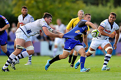 Scott Andrews (Dragons) looks to offload the ball after being tackled - Photo mandatory by-line: Patrick Khachfe/JMP - Mobile: 07966 386802 17/08/2014 - SPORT - RUGBY UNION - Bristol - Clifton Rugby Club - Bristol Rugby v Newport Gwent Dragons - Pre-Season Friendly