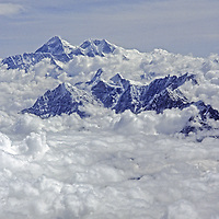 NEPAL, Himalaya. Aerial view of Mount Everest & Lhotse (bkg) & other peaks of Khumbu region, which  tower above pre-monsoon clouds.