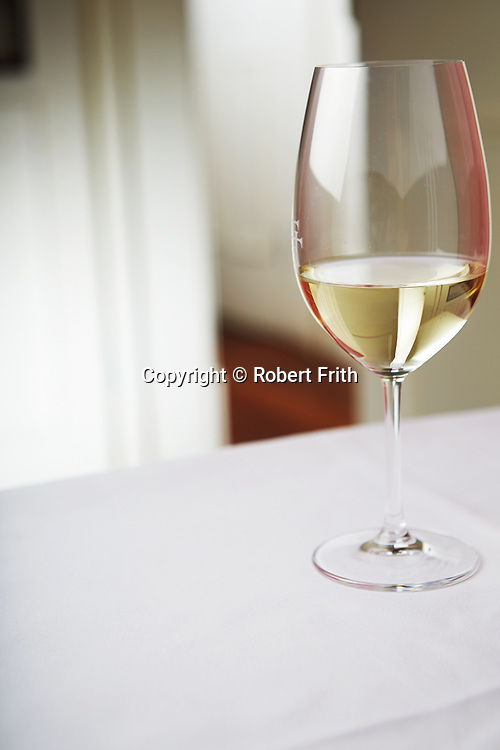 Glass of white wine on a restaurant table