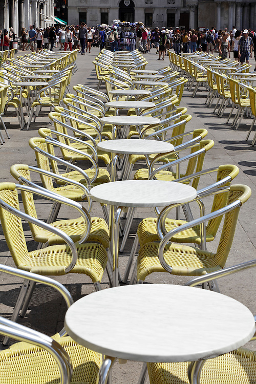tables waiting for people to sit Venice St. Marks square Italy