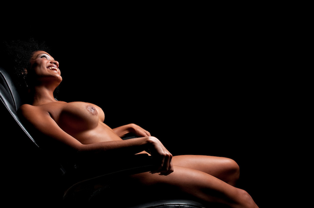 Sensual latin woman smiling nude with sexy look.
