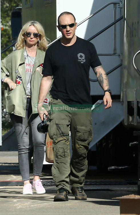 """EXCLUSIVE: Tom Hardy looks battered and bruised, as he is pictured on the set of Fonzo with fellow co-stars Linda Cardellini,Kyle MacLachlan and Noel Fisher for the first time. Hardy could be seen with red welts on his right cheek while sporting Al """"Scarface"""" Capone's facial scars on the other cheek. 12 Apr 2018 Pictured: Tom Hardy. Photo credit: MEGA TheMegaAgency.com +1 888 505 6342"""