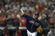 Cleveland pitcher Fausto Carmona makes a throw to first base while surrounded by bugs during Game 2 of the 2007 ALDS at Jacobs Field in Cleveland.