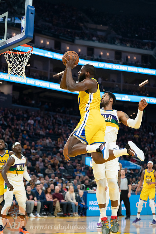 February 23, 2020; San Francisco, California, USA; Golden State Warriors forward Eric Paschall (7) dunks the basketball during the second quarter against the New Orleans Pelicans at Chase Center.