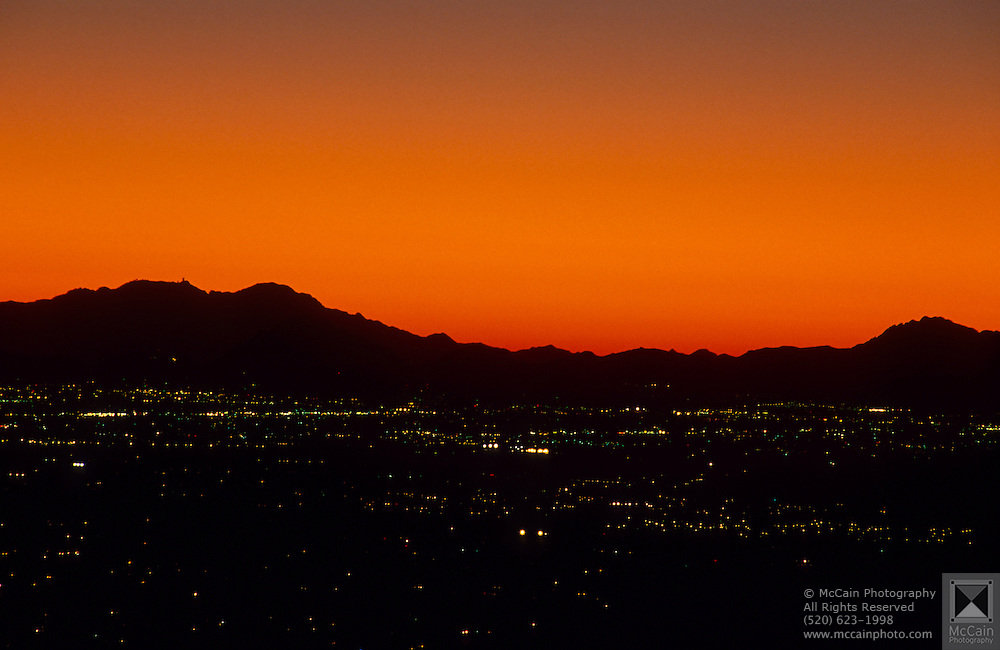 Sunset from Mount Lemmon Hwy, city of Tucson lights in valley below, Tucson, Arizona..Media Usage:.Subject photograph(s) are copyrighted Edward McCain. All rights are reserved except those specifically granted by McCain Photography in writing...McCain Photography.211 S 4th Avenue.Tucson, AZ 85701-2103.(520) 623-1998.mobile: (520) 990-0999.fax: (520) 623-1190.http://www.mccainphoto.com.edward@mccainphoto.com