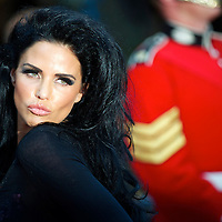 Former glamour model Katie Price arrives for the premiere of 'The Expendables,' on Monday night, August 9, 2010, at the Odeon, Leicester Square in London.