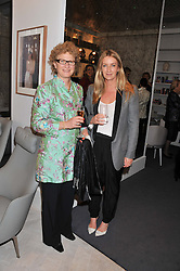 Left to right, SOPHIE MIRMAN winner of the 1988 Veuve Clicquot Business Woman Award and ANYA HINDMARCH winner of the 2012 Veuve Clicquot Business Woman Award attending the Veuve Clicquot Business Woman Previous Winners Dinner held at Grace, 11c West Halkin Street, London on 16th April 2013.