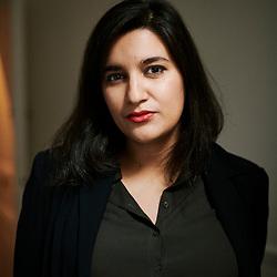 Nassira El Moadem, journalist and writer, posing in her editor's office. Paris, France. October 22, 2019.<br /> Nassira El Moadem, journaliste et ecrivaine, posant dans le bureau de son editeur. Paris, France. 22 octobre 2019.
