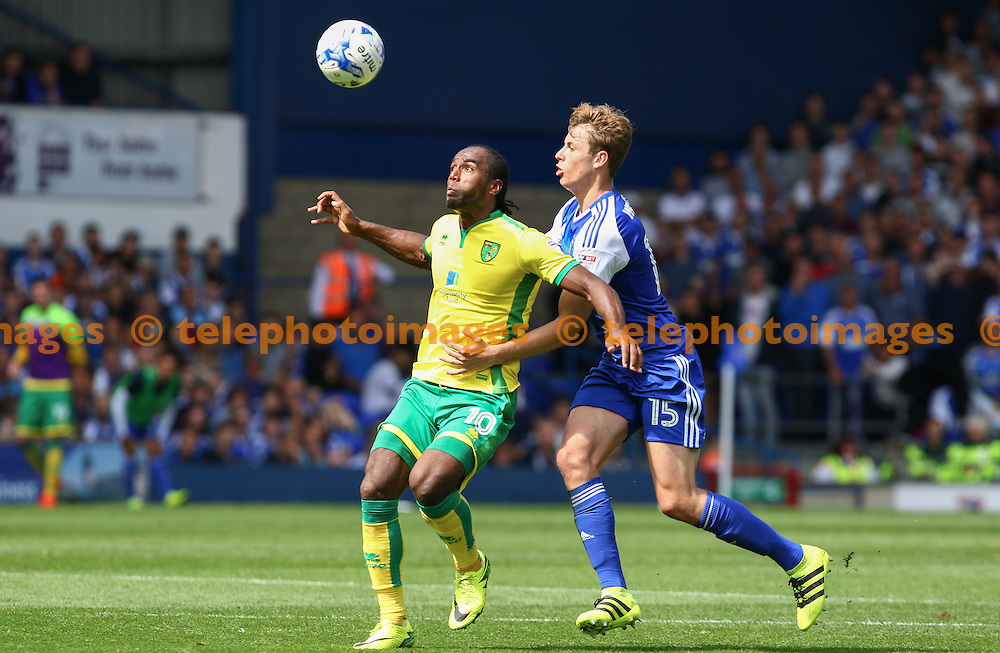 Cameron Jerome of Norwich City (10) holds off a challenge from Adam Webster of Ipswich Town during the Sky Bet Championship match between Ipswich Town and Norwich City at Portman Road in Ipswich. August 21, 2016.<br /> Arron Gent / Telephoto Images<br /> +44 7967 642437