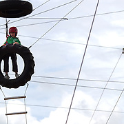 A youngster tackles the course at  Rock'n'Ropes climbing course, Taupo, New Zealand,, 6th January 2010. Photo Tim Clayton