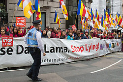 "London, September 21st 2015. Protests by Shugden Buddhists who allege that the Dalai Lama discriminates against their sect, protest outside the Lyceum Theatre in London as the Dalai Lama attends ""An Afternoon With The Dalai Lama And Friends"" event as part of his UK visit. Loyalists staged a counter protest welcoming the Buddhist leader to London. PICTURED: Shugden Buddhists protest against the ""false"" Dalai Lama."