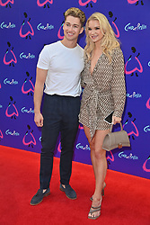 © Licensed to London News Pictures. 25/08/2021. London, UK. AJ PRITCHARD and ABBEY QUINNEN arrives for the gala performance of Andrew Lloyd Webber's Cinderella showing at the Gillian Theatre, Dury Lane. Photo credit: Ray Tang/LNP