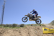 Roger Eggers jumping his BMW HP2 during day 1 competition at 2010 Rawhyde Adventure Rider Challenge