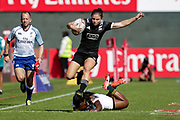 Dubai UAE. Michaela Blyde of New Zealand, evades the tackle off South Africa's Zintle Mpupha during the HSBC World Rugby Women's Sevens Series, 30 November 2017. Photo By Francois Steenkamp/SPORTDXB / www.photosport.nz