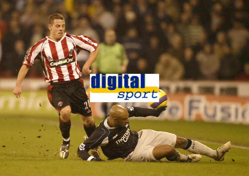 Photo: Aidan Ellis.<br /> Sheffield United v Manchester City. The Barclays Premiership. 26/12/2006.<br /> City's Ousmane Dabo slides in to take the ball from Sheffield's Chris Armstrong