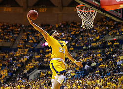 Feb 24, 2018; Morgantown, WV, USA; West Virginia Mountaineers forward Esa Ahmad (23) dunks the ball during the second half against the Iowa State Cyclones at WVU Coliseum. Mandatory Credit: Ben Queen-USA TODAY Sports